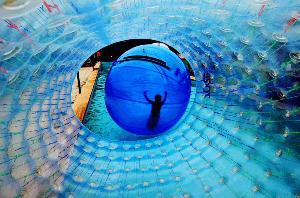 kids-enjoying-aqua-zorbing-at-della-adventure