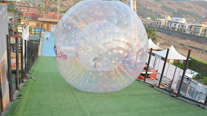 Enjoy  thrilling sport Aqua Zorb at Della