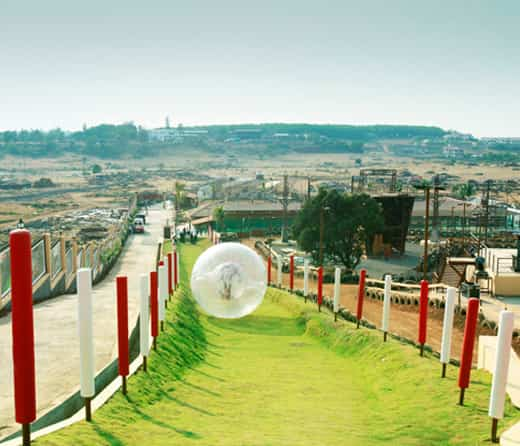 Perform Land Zorbing at Della Adventure