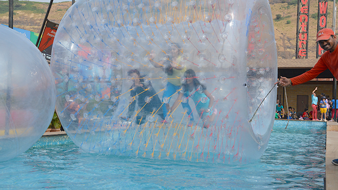 Experience exhilarating activity Roller Zorb at Della, Lonavla