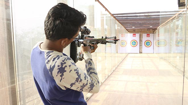 Test your shooting skills with Pistol Bow activity at Della