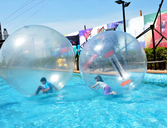 Play Water Zorbing at Della Adventure
