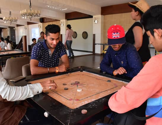 Play Carrom at Della Adventure