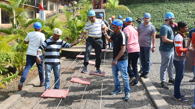 Try team building activity Low Rope Challenge Course at Della Adventure Park
